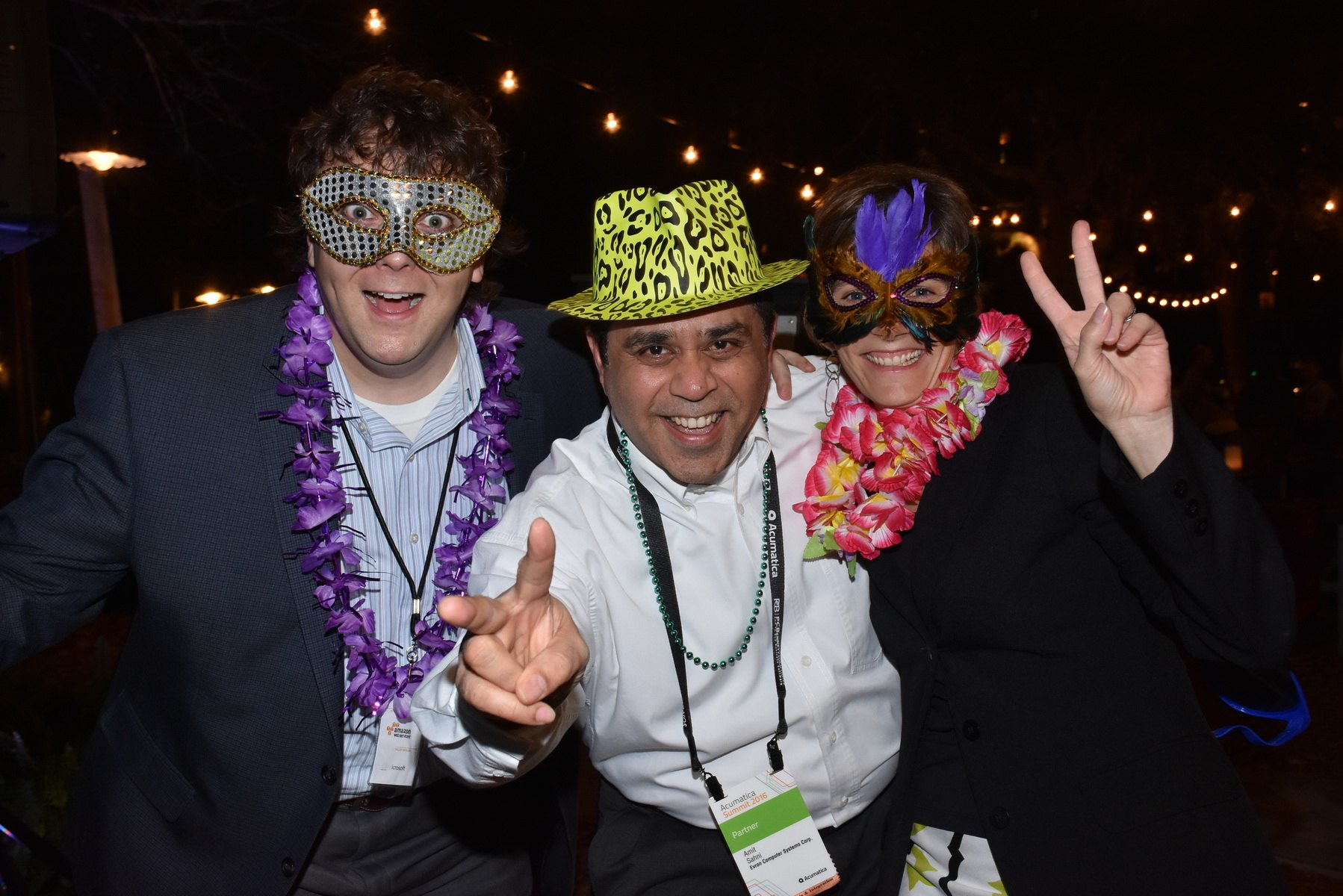 Attendees enjoying the photo booth garb